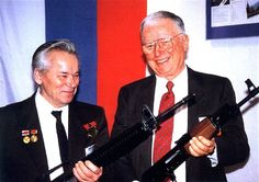 Mikhail Kalashnikov (inventor of the AK-47) and Eugene Stoner (inventor of the AR-15/M16) holding each other's rifles.