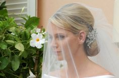 Google Image Result for http://www.glamour.com/weddings/blogs/save-the-date/0704-3-charlene-wittstock-wedding-hair-accessory_we.jpg