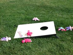 Played cornhole with baby dolls at a coed baby shower. Hilarious!