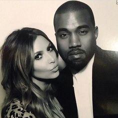 Kim Kardashian & Kanye West strike a glamorous pose on Christmas