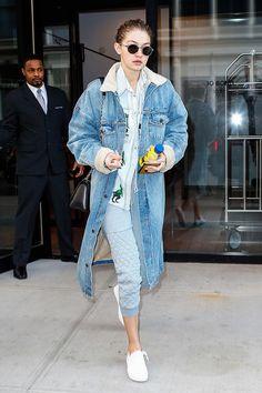 Gigi Hadid throws it back with capris + denim + sneakers.