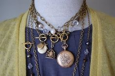 These necklaces are LOVELY!  I have a silver chain and locket and am hoping to get a gold one sometime in the future!  Elizabeth is such a wonderful person and I am so proud of her accomplishments!