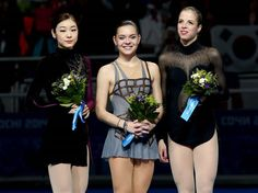 Silver medalist Yuna Kim of South Korea, gold medalist Adelina Sotnikova of Russia and bronze medalist Carolina Kostner of Italy during the ceremony for the Ladies' Figure Skating
