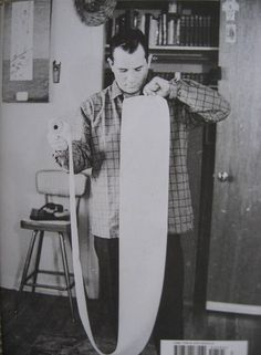 Jack Kerouac and the scroll he would use to write On The Road