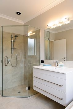 Lighted vanity mirror adds a subtle touch of glam into this bathroom of a G.Gardner home. Lighted Vanity Mirror, Double Vanity, Bathrooms, Touch, Furniture, Home Decor, Bathroom, Bath Room, Double Sink Vanity