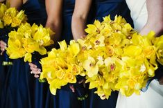 Yellow orchid bouquets. This website also has a wooden bench that has the name of the couple and the date of their wedding carved into the bottom. It was used as a reception decoration, but will serve the couple later.