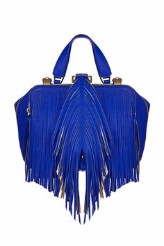 Be a bolder you with this show stopping handbag!  Featuring a cobalt blue leather and gold color block body, along with that dazzling fringe front detail.  Also provides two compartments and a detachable clutch with belt for extra functionality.  Rock it with a feminine maxi skirt and tank for a fun day-to-night style.