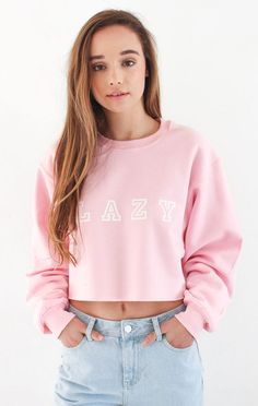 """- Description - Size Guide Details: Get cozy in our super cute 'Lazy' oversized cropped sweater in classic pink. Brand: NYCT Clothing. 50% Cotton 50% Polyester. Imported. Sizing: 40"""" / 101.6 cm width"""