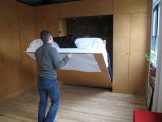 15 Hideaway Storage Ideas for Small Spaces. Matthew McGregor-Mento folds his bed away every morning to make room in his living room for his wife's massage practice. Cama Murphy, Murphy Bed Ikea, Murphy Bed Plans, Fold Up Beds, Modern Murphy Beds, Bed Storage, Storage Ideas, Hidden Bed, Secret Storage