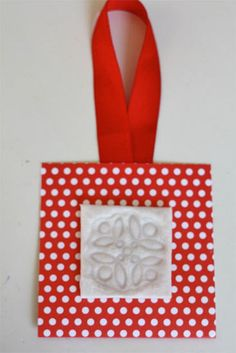 http://factorydirectcraft.com/factorydirectcraft_blog/toilet-paper-ornament - If you have Velvet Ribbon, you can do this as well with it. Place the velvet ribbon face down onto your stamp and using an iron gently press the back of the ribbon.  It will permanently mark it in the shape of your stamp.
