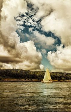 Oh, man… the clouds, the composition… where is this? I want to jump right into this picture Narnia style and swim up to that boat and start my vacation.