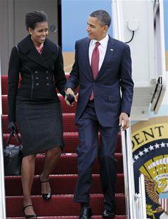 President Barack Obama and first lady Michelle Obama walk down the stairs of Air Force One at Andrews Air Force Base, Md. on Dec. 14, 2011.