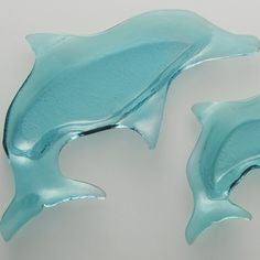 Inspired by the fascinating creatures of the ocean, this Annieglass Large Dolphin piece was designed in support of environmental responsibility. This Large Dolphin brings playfulness to summer barbeques and seaside dining as a whimsical serving piece. Available in a Small Dolphin size.  Add personalized engraving for a unique gift for the ocean lover in your life. 18 x 10""