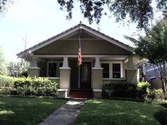 Many historic neighborhoods with charming bungalows and brick streets ring downtown. This is one of my favorite houses.