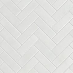 Create a stylish tile design with our timeless Calacatta Honed Marble Herringbone Mosaic tiles. Honed Marble, Calacatta, White Herringbone Tile, Mandarin Stone, Classic White Kitchen, Natural Stone Flooring, Wood Floor Texture, Mosaic Tiles, Stone Tiles