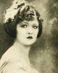 Beautiful silent film star, Laura la Plante, 1924.