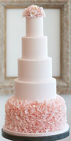 A tower of pink! Gorgeous pink ruffle wedding cake by Bobbette & Belle.