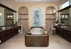 bathroom - walkthrough shower and tub with backsplash sculpture