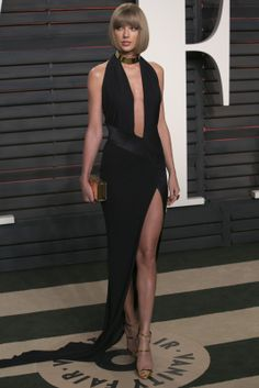 Wow, Taylor! We haven't seen a look this sexy from the singer ... ever. The star, 26, looked like a supermodel in the plunging black gown with a sexy thigh-high slit and metallic choker. (Photo credit should read ADRIAN SANCHEZ-GONZALEZ/AFP/Getty Images)                                     via @AOL_Lifestyle Read more: http://www.aol.com/article/2016/03/02/sexy-stars-kate-hudson-margot-robbie-and-more-stun-in-revealin/21321839/?a_dgi=aolshare_pinterest#slide=3815557|fulls...