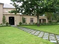 Pavers set on the diagonal draw the eye straight toward the entrance of this home. Dwarf monkey grass planted between them emphasizes their diamond pattern and gives the path dimension.