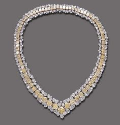 "A SPECTACULAR DIAMOND AND COLORED DIAMOND ""METAMORPHIS"" NECKLACE, BY GRAFF  Composed of a flexible line of graduated modifed rectangular-cut yellow diamonds, flanked on both sides by pear-shaped and circular-cut diamond borders, mounted in platinum and 18k gold, 20 ins.  Signed Graff, no. 3912"