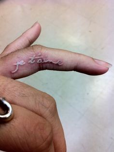 """""""I love you"""" in French. Written in white ink, placed on the ring finger. love it!"""