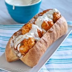 Buffalo Chicken Meatball Subs with Blue Cheese Dressing... halve the recipe and use with leftover meatballs from Italian wedding soup.  Sub mayo in dressing for Greek yogurt.  Add baby spinach.