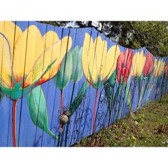 pretty painted fence...or try a picket fence painted scene with wildflowers, a path leading off to a secret place
