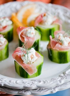 Proscuitto, Sour Cream and Feta stuffed cucumbers.... Maybe Landon will eat this if I sub cream cheese instead of feta,..