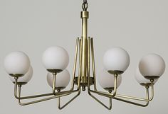 Marvelously mid-century, our Fey Chandelier is a stunningly retro choice for above a simple and sleek wooden table.
