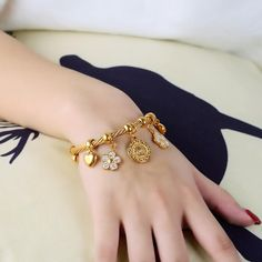 DESCRIPTION & DETAILS Cute and chunky this charm bracelet features 5 beautiful charms beaded onto a gold rope bangle bracelet. Gold Jewelry Simple, Stylish Jewelry, Fashion Jewelry, Gold Bangles, Bangle Bracelets, Gold Bracelet For Women, Gold Jewellery Design, Necklace Designs, Mangalsutra Bracelet