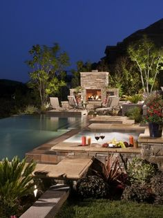 Fireplace, hot tub, pool and a great view.  Magical outdoor setting complete with wine and cheese...yes, please!