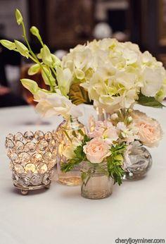 Hydrangea and pastel flower centerpiece with vintage glass votive holders