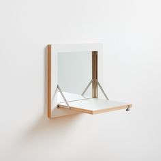 Fläpps Vanity Mirror  This makeup mirror is the flat brother of Schminktank for those who already have the right place to put their makeup utensils. The wall shelf with mirror disappears on the wall in no time and and can be put up if required.