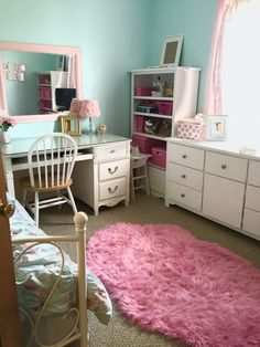 Pink and blue girl's room with canopy and tree mural. Shabby chic bedroom.