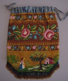 Victorian beaded drawstring purse. Browse the collection of antique purses on this page. It's amazing!!!