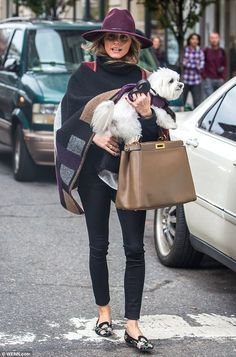 Olivia Palermo wearing Alexander McQueen Suede Embroidered Loafers, Burberry Colour Block Check Blanket Poncho, Fendi Leather Peek-a-Boo Satchel and Janessa Leone Vera Fedora