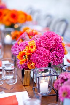 pink and orange flower candles | Hot Pink and Orange Centerpieces Outdoor Weddings Evantine Design