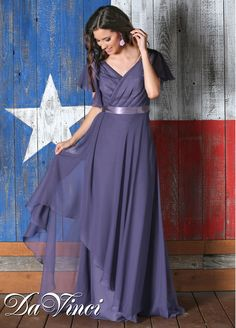 Discover one of our most flattering bridesmaid dresses, plus sizes included, in Spring 2015 DaVinci Style 60193. An elegant, faux-wrap chiffon dress with V neckline and butterfly sleeves, this bridesmaids gown has stunning details like a satin ribbon belt at the natural waist, gathered bodice, and long skirt with asymmetrical layers. One of our more versatile bridesmaid dress designs, it's suitable for mothers of the bride and groom too. Shown in lavender, order in 50+ gorgeous shades.