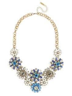 A multihued indigo statement necklace that features whimsical flowers crafted from faceted baguettes and marquise-cut gems for a jaw-dropping effect.