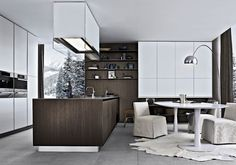 Poliform Italy - love the walnut & white kitchen, oversized hood fan & a kitchen that feels like any family can settle into