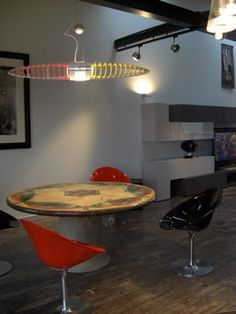 Titania Queen lamp reminds me of a flying spaceship.  The colors can be changed. At #LuxLoft, vacation rental Liepaja.