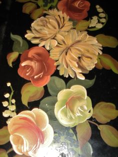one of a pair of lovely vintage/antique toleware black long trays that I have- they have pierced and gilded sides.