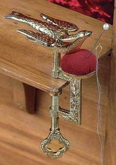 (A bit of sewing history) Commonly used in the Victorian home, this third hand clamps to a table while the beak holds the fabric to be sewn. Depressing the tail releases the beak enabling the fabric to be repositioned or removed. Before the invention of the sewing machine, clothing, sheets, and other household items were sewn by hand, this handy little clamp was often used for hemming.