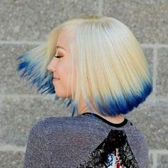 Dipped in Ink   This bob is taken to another level with the deep blue hair ends. The color contrasts beautifully with the white blonde hair, which is a must in scene hair
