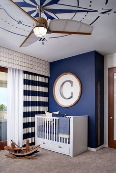 10 Ways to Embrace Sun, Sand and Sea in the Modern Nursery Hard to miss the nautical influence in this nursery [Design: Camico Graphics]