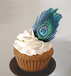 Make your homemade or store bakery cake look fabulous with custom wafer paper decorations. Wafer paper is an edible paper that can be printed using edible ink, and placed on frosting or fondant. My wafer paper peacock feather cutouts are different than most, because you have the choice to make them double-sided, so you can stand them up and wont see the unsightly blank side on your cake.  These detailed, pre-cut feathers are 1.6 wide and 2.75 tall. Each set contains 24 feathers which are…