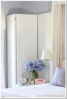 A DIY folding screen made from re-used narrow doors. Project can be found at: http://inmyownstyle.com (Search DIY Folding Screen)