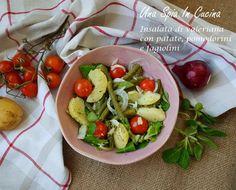 Insalata di valeriana con patate, pomodorini e fagiolini