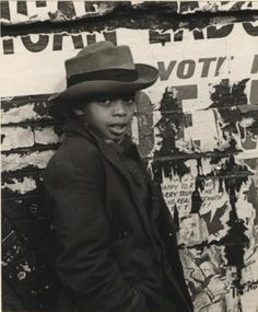 Helen Levitt, Boy leaning against wheatpasted wall, New York, 1939
